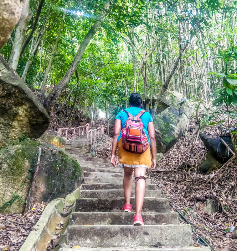 a hiker hiking up Penang hill to arrive at the summit. Fight for your dreams so that you can reach at the top, the photos shows that.