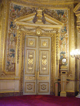 Photo: One of the Hall's ornate doors, with multiple occurrences of the RF seal.