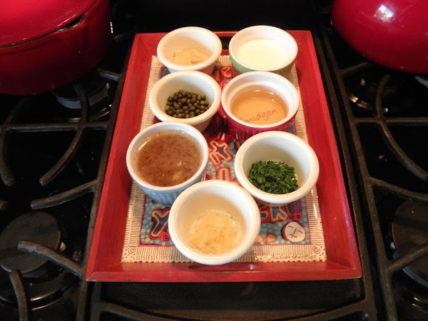 Measure Green Peppercorns, Dijon Mustard, Chopped Chives, Crushed Garlic, Dry vermouth, Heavy Cream, and...