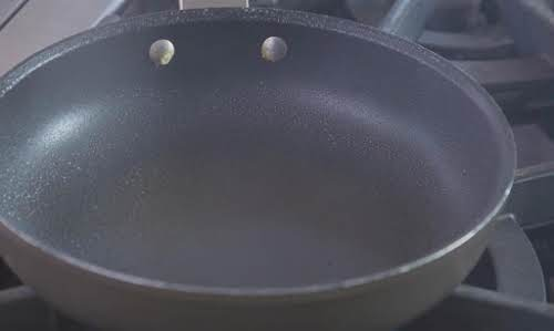 Spray a skillet with cooking spray and turn heat to medium-high.
