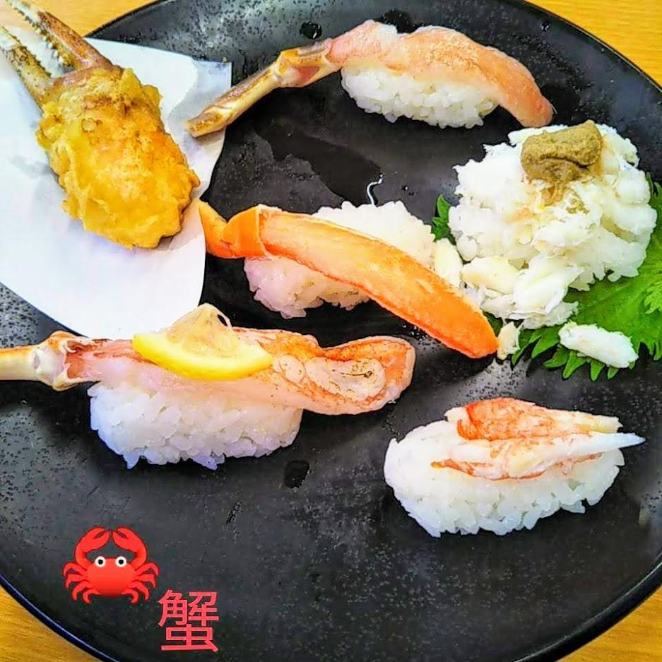 カニのお寿司が乗った皿