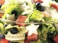 Put chopped romaine in large bowl, Add marinated fruit and dressing and toss, top...