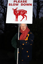 Photo: Marion holds a sign that was proposed to the Oak Bay Council.