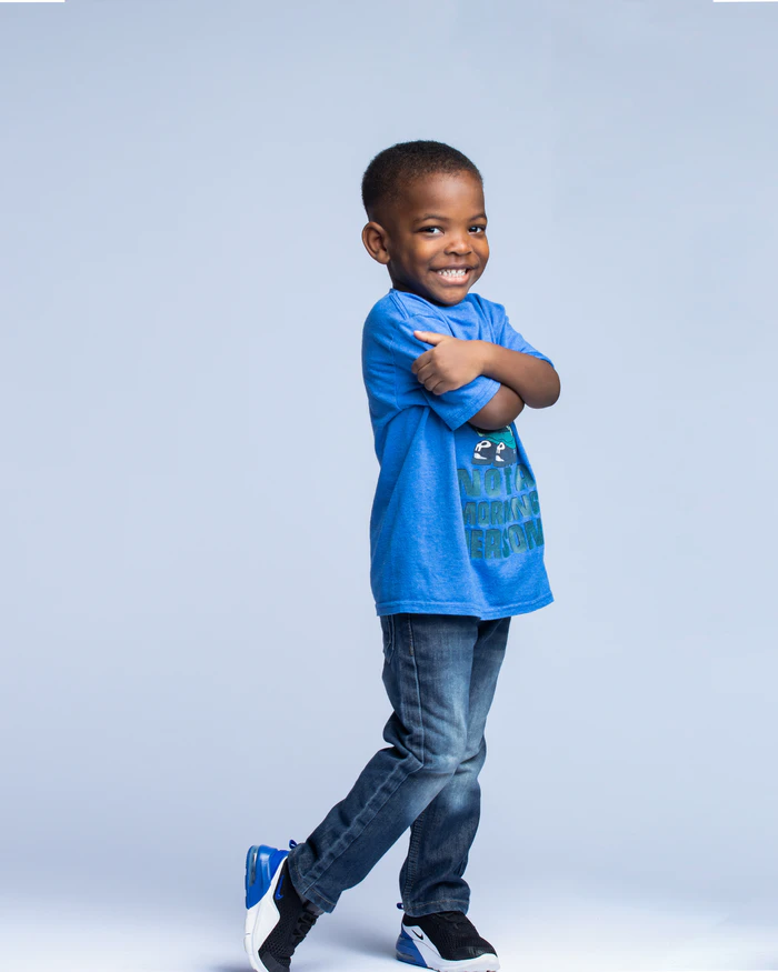 child posed against blue background