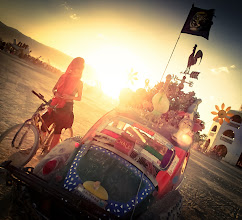 Photo: A lavishly decorated bug is visited by a curious girl on a bike...