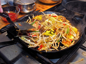 Photo: tossing the mussel cakes with the flavored wilted bean sprouts
