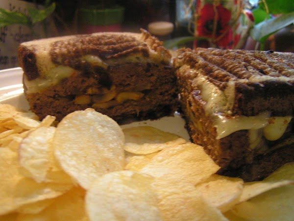 Over a medium high heat; brown sammies on both sides until lightly brown and...