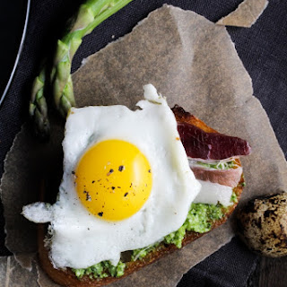 Duck Fat Toasts with Quail Eggs and Asparagus Pesto