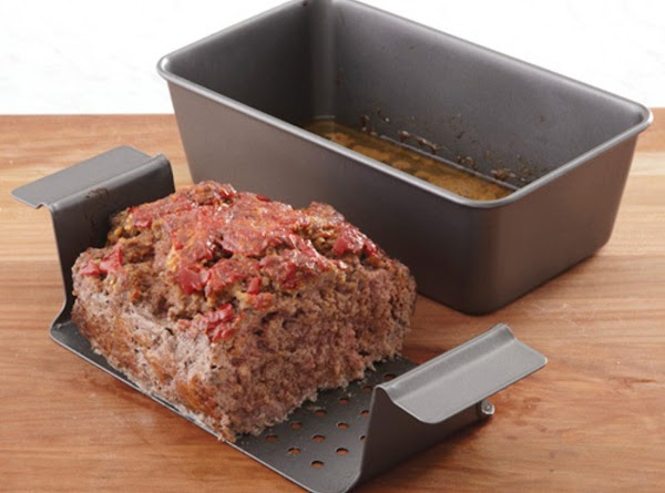 Preheat oven to 350°F. Grease a loaf pan or Perfect Meatloaf® pan.