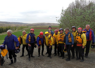 Photo: Our group after an hour of river rafting on the 38 degree Hvita glacial river.  Even with these clothes we were cold and wet, but it sure was a fun experience!