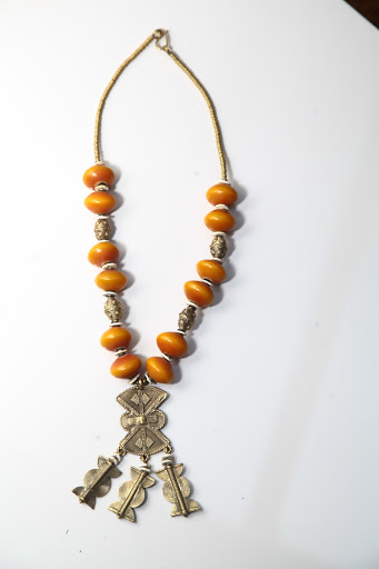 African Heritage necklace of amber and cast brass beads