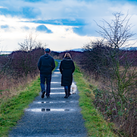 by Keith Sutherland - People Couples ( puddles, walking, shore, trail. couple, grey day, dog )