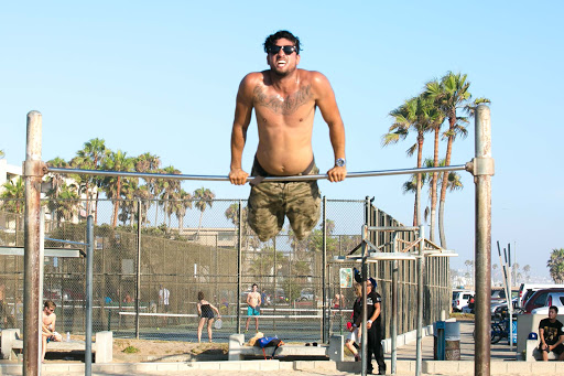 Pullups-at-Muscle-Beach.jpg - A local man goes through his fitness regimen at  Muscle Beach in Venice, California, where spectators gather to gawk and marvel.