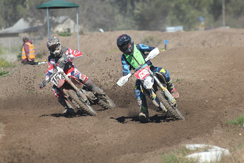 Narrabri's Jack Squire and Tamworth's Luke Hawkins in action at Newtown Park in round four of the Narrabri Dirt Bike Club's motocross series on Sunday.