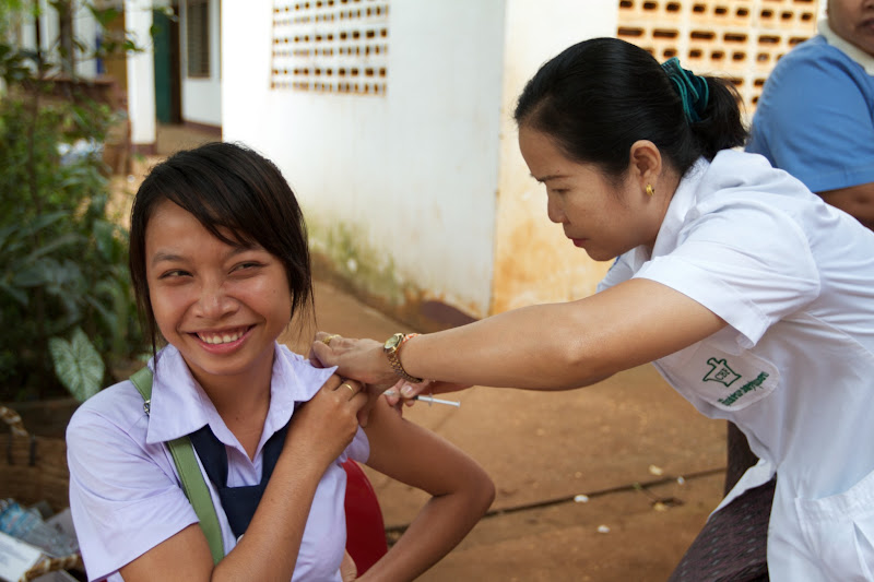 Photo: A girl receives measles and rubella vaccination in Lao PDR.  A combined measles-rubella vaccine costs about USD1.50. Adding rubella to vaccination programmes will help to stop the rubella virus, which can cause devastating birth defects to newborns including blindness, deafness and heart conditions.   Photo credit: Measles and Rubella Initiative/Christine McNab