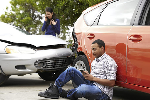 Two motorists are frantic on their phones after a crash.