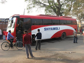 Photo: A typical Shyamoli Transoportation long distance bus waiting for passengers from Dhaka at Petrapole (West Bengal) border