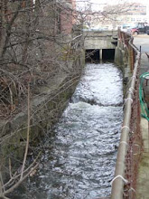 Photo: Upstream view at 31 Revere Rd.  Legion Post #95 on left Hancock Parking Lot in bacground