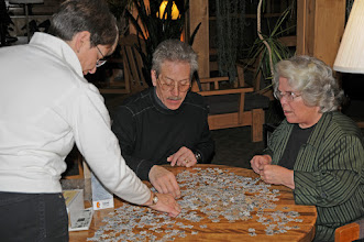 Photo: The puzzle fun begins; Michelle, Laurie, and Beto