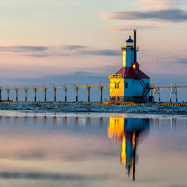 Sunset Glow on the Lighthouses by Carol Ward - Buildings & Architecture Public & Historical ( reflection, lake michigan, sunset glow, lighthouses, st joseph pier lighthouses, buildings, architecture, historic )