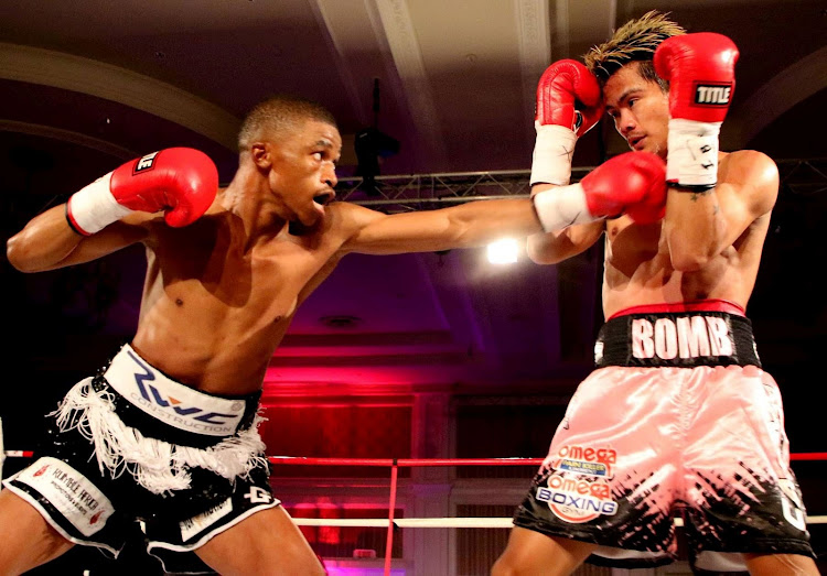 Sive Nontshinga throws a jab at Filipino Christian Araneta in their IBF world junior-flyweight title eliminator at the Boardwalk in Gqeberha on Saturday April 24 2021.