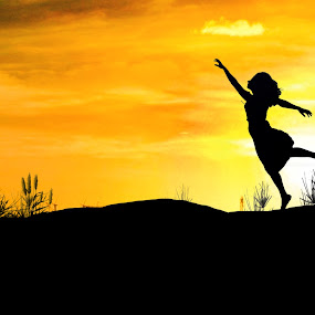 Dancing by Berril Pratama - People Fine Art ( orange, woman, sunset, art, siloute, silhoutte, sun )