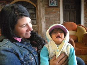 Photo: Paula enjoys a little one in the Hosteria Alpaka sitting room.