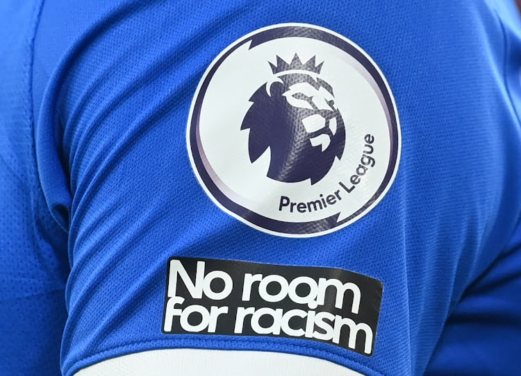 The No room for racism logo is seen on the shirt of Brighton & Hove Albion player