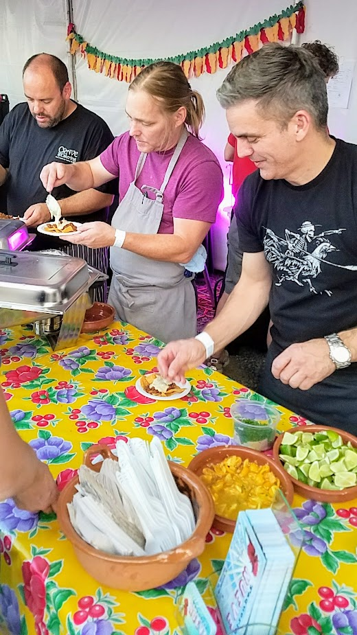 Recap of Feast Night Market 2017: Billy Schumaker of Taqueria Nueve dishing up Smoked Gouda Fundido with Beef Chorizo
