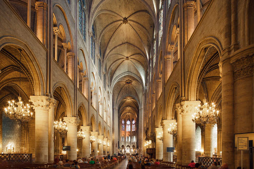 The interior of Notre Dame dazzles visitors in Paris.