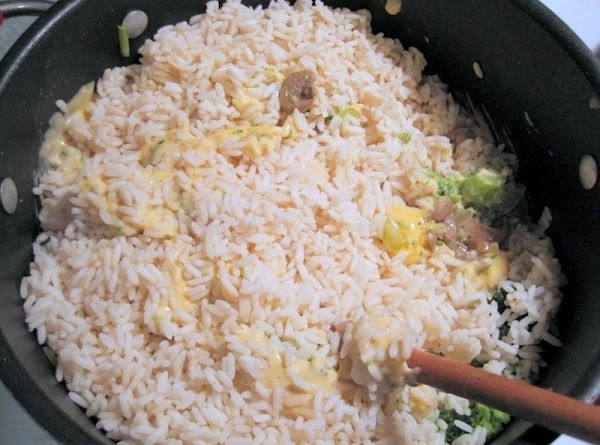 Cook rice according to package directions. Mix all ingredients including the broccoli.