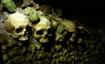 Photo: Endless rows and rows of femur bones and skulls in the catacombs.  6,000,000 people's remains are here.