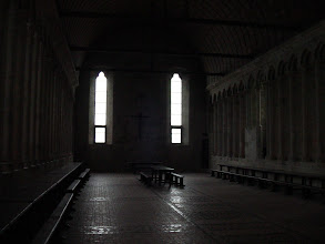 Photo: We are now inside the Refectory, one of the structures of La Merveille, and a central meeting a dining room for the religious community. It is considerable more illuminated than this picture shows, since the two main windows are supplemented by a larger number of thin widows not visible along the side walls.