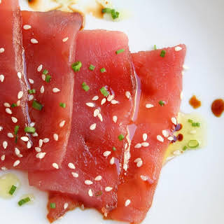 Sashimi with Soy Sauce, Sesame Seeds, and Chives.