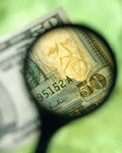 Photo: Magnifying Glass and U.S. Fifty Dollar Bill