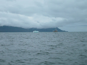 Photo: A fishing boat approaches an iceberg in Frededick Sound.