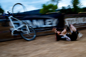 Photo: Joey Mullan clips and then rag dolls the barrier during a heat of the Single Speed Eliminator race. That was spectacular and Bro flew about 10 feet in the air. After writhing aroiund in pain for 10 minutes he was OK!