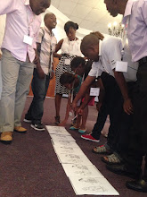 Photo: Submitted by Save the Children; Photo by Julia Crowley  Participants work together to complete an exercise at a TOPS Nutrition/Social and Behavioral Change Workshop in Blantyre, Malawi.