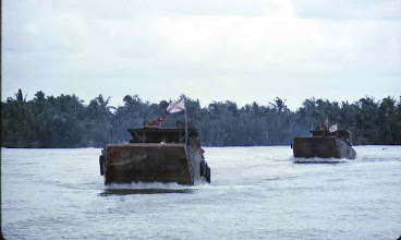 Photo: 231st flying the FL Flags sent by Gov Kirk to our unit.  Note the shoreline.  Kind of ambush looking?