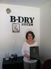 Photo: Jackie Qualter of B-Dry Systems M/E in Billerica, MA, celebrating 30 years as an Accredited Business