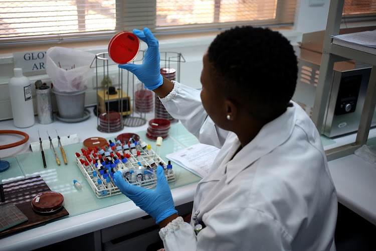 Medical technologist Bolele Disenyeng, seen in a lab at The National Institute for Communicable Diseases in Johannesburg. The institute is dealing with the listeriosis outbreak in South Africa.