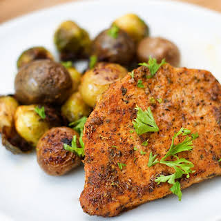Ranch Pork Chop Sheet Pan Meal with Potatoes and Brussel Sprouts.