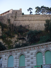 Photo: Now in Monaco, the bus drops us off at La Place d'Armes, looking up at Le Rocher (The Rock), where we are headed.