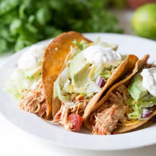 Slow Cooker Mexican Shredded Chicken Tacos.