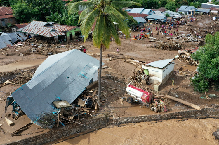 An aerial picture shows damaged houses affected by flash floods after heavy rains in East Flores, East Nusa Tenggara province, Indonesia April 6, 2021.