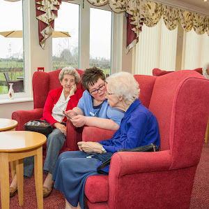 a carer advising two elderly ladies