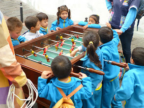 Photo: La Ronda street: kids at foosball table