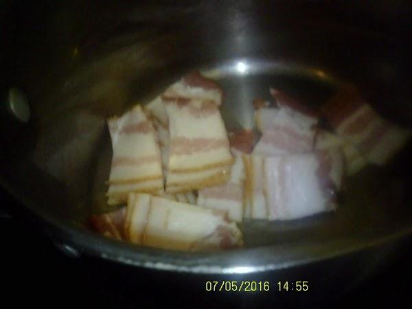 In a medium sauce pan on medium low heat, render bacon until crisp, but...