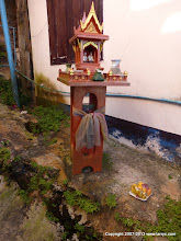 Photo: Small home shrine, with offering of fruit.