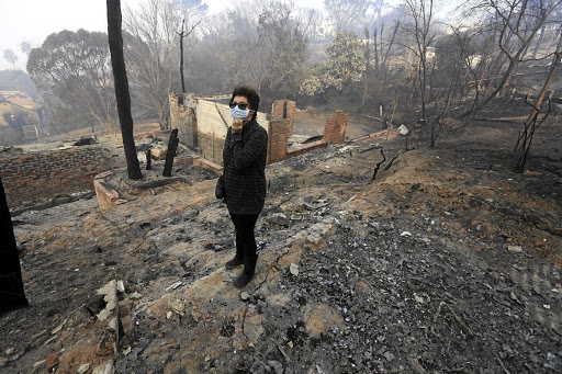 BURNT: Susan Campbell surveys her property  in Paradise, Knysna, which was destroyed by the recent fire Picture: ESA ALEXANDER